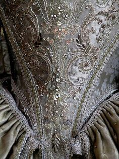 I was wearing the silver princess's dress; the skirts drifted around me in a shining mist, and I wondered how I hadn't noticed before that my straggling hair was clean again, and combed, and pinned to my head.
