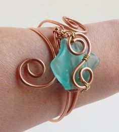 Wire Wrap Sea Glass Bracelet, Aqua Glass sold by SerendipitiniJewelry. Shop more products from SerendipitiniJewelry on Storenvy, the home of independent small businesses all over the world. Wire Jewelry Rings, Handmade Jewelry Bracelets, Unique Bracelets, Sea Glass Jewelry, Jewelry Crafts, Beaded Jewelry, Bohemian Necklace, Bohemian Jewelry, Aqua Glass
