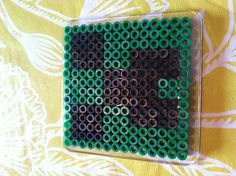 A creeper from minecraft activity beads just follow along from the picture... SUPER EASY!!!