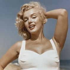 20 most iconic beach hair of all time: Marilyn Monroe embodies the essence of sex on the beach.