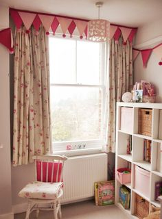 Bright and fun, floral fabric runs through pencil-pleat, taped-heading, curtains and matching bedspread.  Pelmet is then accessorised with handmade bunting...
