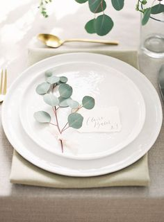 Lunchtime #Wedding Treat - This simple sprig of eucalyptus on a white china plate with a beautiful calligraphy written name place looks to pretty. Simple, elegant and chic.  Picture by Alicia Lacey Photography