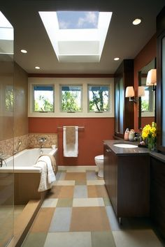 Contemporary Full Bathroom with Full Bath, ceramic tile floors, Wall sconce, Flush, European Cabinets, Shower, can lights