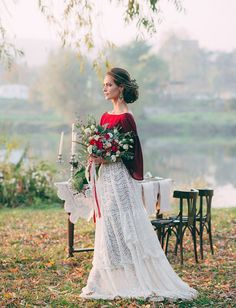 A burgundy and crimson top/cape made one picture perfect addition to this bride's lace dress and skirt. We love this autumn/fall spin on the traditional wedding dress.