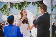 A photojournalistic photograph of a bride laughing during her wedding ceremony on cape cod Gina Brocker Photography