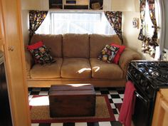 Love the black & white floor in this Airstream trailer!  A real couch makes it very classy and comfortable looking.