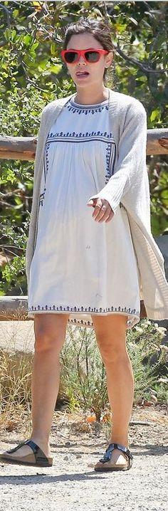 Rachel Bilson in a white print dress, red sunglasses, and black flat sandals
