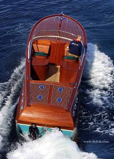 Can't you just hear those inboards opening up? A really sweet Dolvik wooden boat...