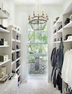 A clean, white modern french closet. An antique French chandelier hangs in the closet of a New Orleans house by Lee Ledbetter. Closet Designs and Dressing Room Ideas Photos Master Closet, Closet Bedroom, Closet Space, Wardrobe Room, Master Bedroom, Hallway Closet, White Wardrobe, Extra Bedroom, Walk In Wardrobe