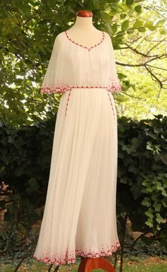This is the dress - but not long, knee lenght, with red flowers and red shoes