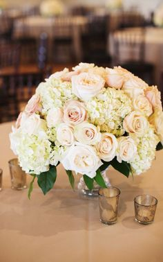 Photographer: EE Photography; Wedding reception centerpiece idea