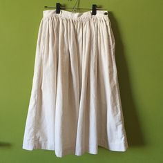"""Japanese corduroy midi skirt!  Rare find from Japanese brand 45R. Purchased in Tokyo. Can't believe I'm selling but need to reduce my closet. Super rich fabric, can be dressed up or down! Pair with a bring collared shirt or crop top! Waist is 14"""" flat. Probably a small or medium. Hits higher waisted.  Skirts Midi"""