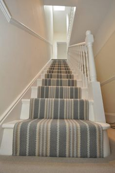 I hope you learned a thing or two about how to choose and lay a stair runner from this overview! If you are ready to pull the trigger and shop for a stair runner, I have included several stair carpet runner ideas below! Striped Carpet Stairs, Patterned Stair Carpet, Stairway Carpet, Striped Carpets, Hallway Carpet, Hallway Flooring, Bedroom Carpet, Tartan Stair Carpet, Hardwood Stairs