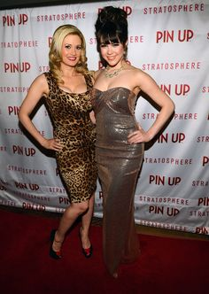"Holly Madison Photos Photos - Model and television personality Holly Madison (L) and model Claire Sinclair arrive at the premiere of the show ""Pin Up"" at the Stratosphere Casino Hotel on April 29, 2013 in Las Vegas, Nevada. - 'Pin Up' Show Premieres in Las Vegas"