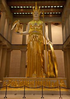 Athena statue inside the Parthenon Art Gallery. The figure in her hand is taller than 6 feet