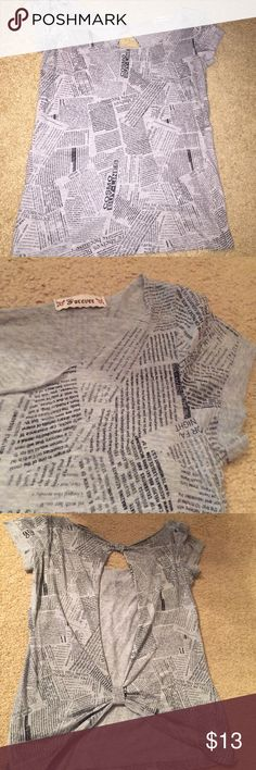 Unique newspaper print shirt, cut out back You'll be all the buzz in this newspaper printed tshirt from Forever 21! The neck is wide enough that you can wear it normally or pull one side off of your shoulder! The back is SO cute! Check the pictures to see the different cut outs! No size tag but would fit a small or a medium. (Not anthropologie) Tops Tees - Short Sleeve