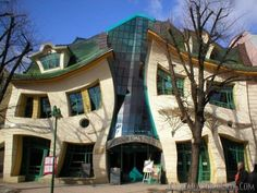 The Crooked House in SoPot, Poland It looks like something unreal – may be a surrealist painting or a cartoon but it is a real building. The most photographed building in Poland, the Crooked house is located in Rezydent shopping center in Sopot, Poland Unusual Buildings, Interesting Buildings, Amazing Buildings, Amazing Houses, Sopot Poland, Houses In Poland, Architecture Cool, Crooked House, Crooked Man