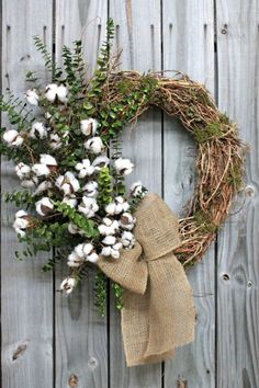 A Preserved Eucalyptus and raw Cotton boll wreath finished with a burlap bow. Country Wreaths, Fall Wreaths, Door Wreaths, Christmas Wreath Image, Christmas Wreaths, Christmas Decorations, Christmas Ideas, Diy Wreath, Grapevine Wreath