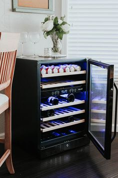 Impress your guests with the sheek black stainless steel wine cooler.