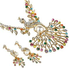 Swarovski crystals jewellery set, Beautiful Peacock style Swarovski Crystal Necklace & Earrings set. Stunning large necklace with elegant matching earrings. Set in a Gorgeous Peacock design with large Pearl in centre, very elegant look! 2 colour options; Various Multi Coloured Swarovski Crystals on 14K Gold Plating & Clear Swarovski Crystals on a Silver Rhodium plated finish.    Sale:$127.98