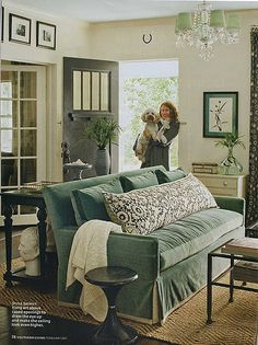 I love the front door, the pictures over the doorway, the frenchdoors opening into the other room, that rug, the color of the couch, and that IMMENSE pillow (that'd keep the hubby from getting too comfy on my couch, hahaha...may even keep the dogs off!)
