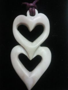 two love hearts;  hand carved bone pendant…