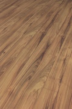 New in - Hickory 10mm Laminate Flooring. We are loving the natural colour variance of this one! Available at doorandfloorstore.co.uk
