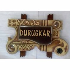 Name plate on the front door of house gives the first impression of any house and makes it look impressive and stylish. Modern name plate design ideas helps in making amazing and stylish looking flats. Wooden Crafts, Clay Crafts, Arts And Crafts, Wooden Name Plates, Name Plate Design, Name Plates For Home, Interior Design Videos, Name Boards, Modern Names