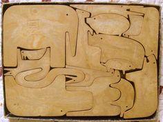 Enzo Mari's 16 animals wooden puzzle
