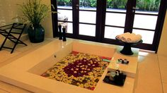 Unwind in the bathtub -- filled with scented frangipani flowers -- at The Istana in Bali.