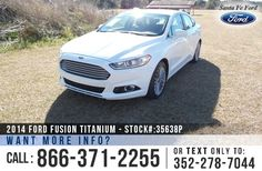 2014 Ford Fusion Titanium - Mid-Size Sedan - I-4 2.0L Engine - Keypad Door Lock - Remote Keyless Entry - Alloy Wheels - Spoiler - Fog Lights - Leather Seats - Safety Airbags - Seats 5 - Power Windows, Locks, Mirrors, Driver & Passenger Seats - AM/FM/CD/MP3 - Touchscreen System - iPod/Aux/USB/Bluetooth - SYNC by Microsoft - Remote and Push Button Start - Digital Compass - Outside Temperature Display - Heated Front Seats - SD Card Reader - Backup Camera - Cruise Control and more!