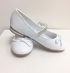 Low heel girl's shoes with rhinestones strap. Please note: First Communion dresses and accessories are final sale. First Communion Shoes, First Communion Dresses, Girls Heels, Final Sale, Low Heels, Rhinestones, Note, Sneakers, Kids