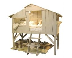 Cool idea! I have a Rabbit hutch that I may turn into a dog house something like this..