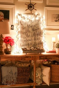 The glow of Christmas lights is so warm and cozy!! O Holy Night DIY sign lit up only with the glow of string lights ...