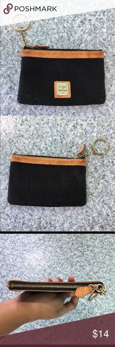 """Dooney & Bourke Pouch Dooney & Bourke Pouch. 5.75"""" wide, 3.5"""" long. Minor wear see pics 6&7, the mental plate has scratches from wear & 1 small water mark on the inside. Zipper works great and still has lots of life left in her Dooney & Bourke Bags Mini Bags"""