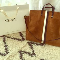 Clare Vivier simple tote Beautiful real suede Clare Vivier simple tote, gently loved but in excellent condition with removable long strap, blk and wh stripes down both sides, lots of room inside still retails in her store for $485, original packaging as well Clare Vivier Bags Totes