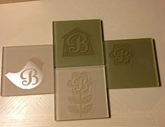 DIY coasters made using glass etching cream, vinyl and Cricut Songbird cartridge.