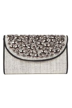 The West Palm Woven Clutch is a glammed-up version of your favorite Summer clutch.