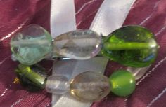 """medium hair clip; green and clear glass beads 2"""" by 1""""  product #H017  $5.00"""