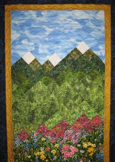 This art quilt fabric wall hanging starts at the bottom with a small stream complete with rocks and ferns. Pink, yellow and blue flowers surround the mountain stream. The image then moves into a grassy meadow of pink flowers nestled beneath green trees. The trees lead you to the green snow capped mountains beneath a bright blue sky - so typical of Lake Tahoe where I live. I used a small inner border of a gold fabric, with a dark blue fabric for the border. A stunning addition to your wall…