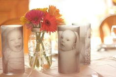 Centerpiece from my daughters baptism.  Can also serve as a great gift. You need : vases from $1 store. Vellum paper, votive candles,  and spray adhesive glue. Print favorite pictures in b on vellum paper. When dry, glue to vase with spray adhesive. Pop in candle and you're done. Super easy and cute :)