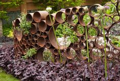 garden art 19 Creative DIY Rusted Metal Projects To Beautify Your Yard