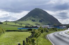 North Berwick Law ~  Non-active volcanic hill  rises 615 ft. above the town of North Berwick on the East Coast of Scotland, south of Edinburgh.