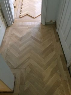 In progress of laying a prime grade oak parquet in a Herringbone pattern.