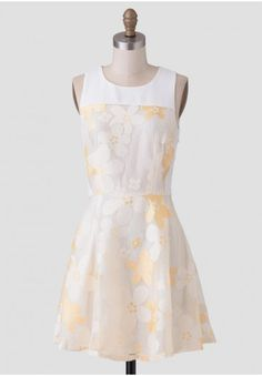 This beautiful dress caught our eye! With floral print and hints of custard throughout this dress is perfect for spring!