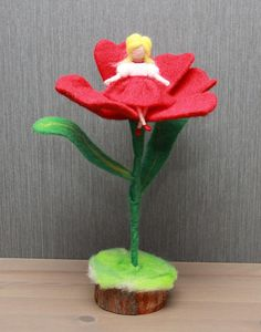 Needle felted doll Thumbelina on the flower. Wool baby doll.