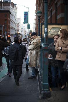 man in the street #fur #newyork #bored