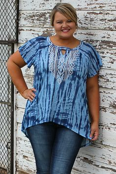 """Our Can You Feel It Tie-Dyed Tunic With Key Hole is made of 100% Polyester. It measures 28"""" long from shoulder to hem. The sizing available is 12/14, 14/16 and 16/1"""