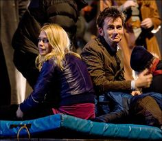 David Tennant and Billie Piper.. David looks guilty. DID HE EAT ALL THE COOKIES.... AGAIN?!?!