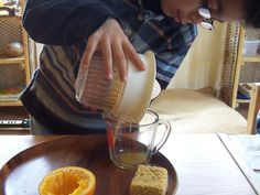 Montessori Practical Life orange juice squeeze tea party, and a little Social Grace and Courtesy, from the {Montessori on a Budget} blog. #Montessori